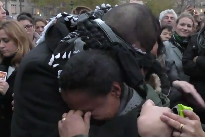 People in tears by French Muslim`s hug me if you trust me appeal
