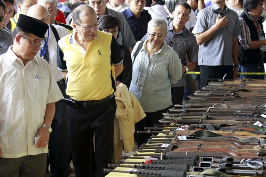 Philippine Muslim separatists hand over weapons in push for peace