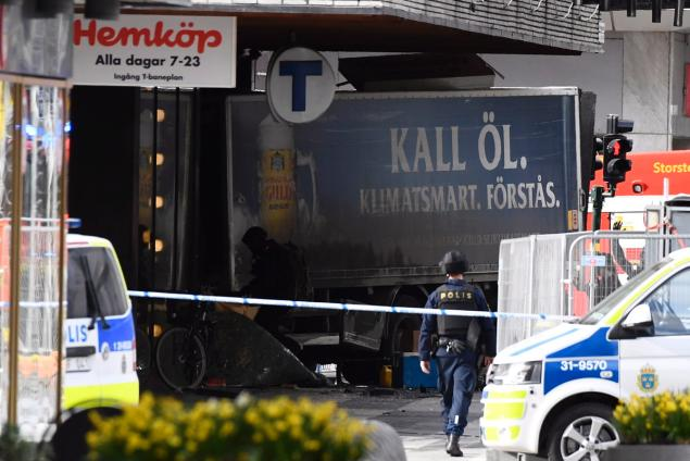 Truck crashes into Sweden store, three people dead