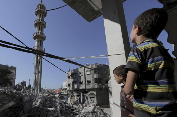 Gaza residents return to destroyed homes