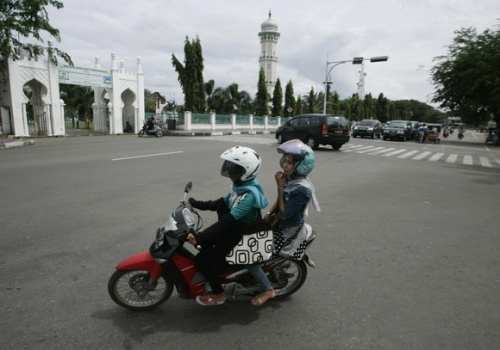 Motorcycle taxis launched for Muslim women in Indonesia