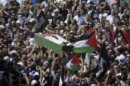 Despite Israeli Restrictions, Thousands Attend Funeral of Slain Palestinian Boy